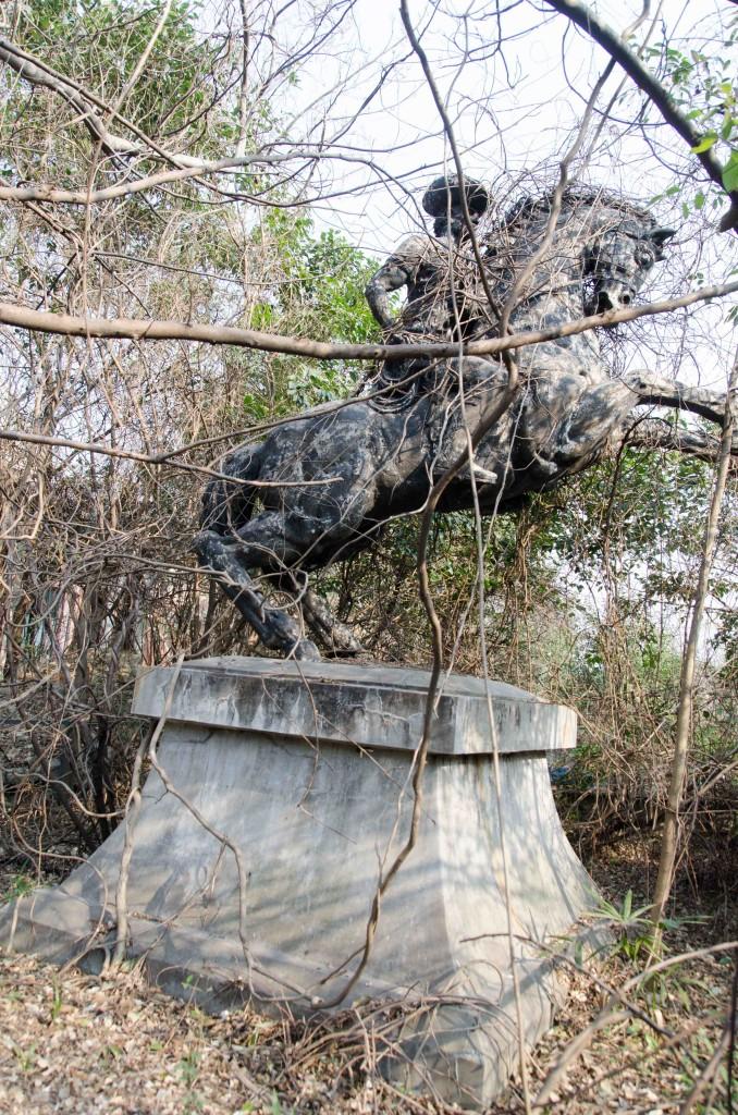 overgrown horse statue